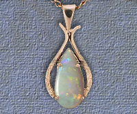 Genuine opal pendants and jewellery by laszlos opals and jewelry crystal opal pendant design number op25 sold this opal pendant has a red opal solid mounted in a 14k yellow gold setting the opal weighs 195 carats aloadofball Images